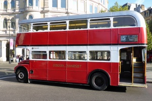 The old familiar of London. Not a black cat, but a red bus with an open platform.
