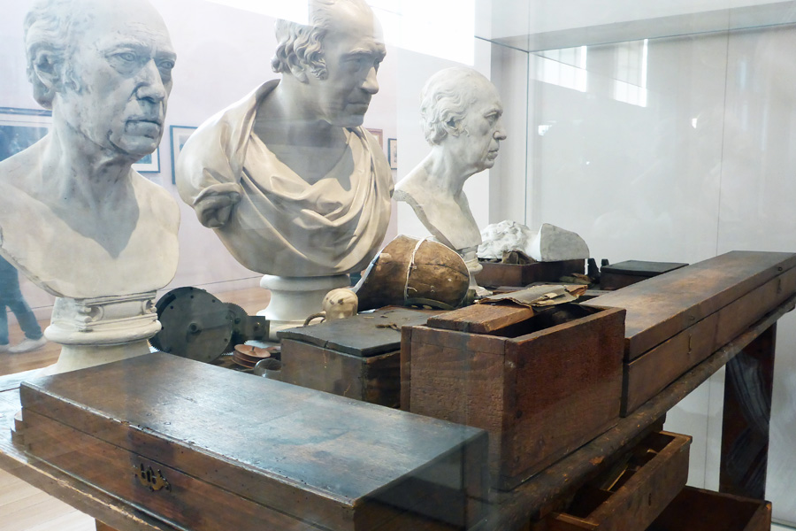 Mr James Watt's actual workbench, although I don't think the busts were there when it was in use.