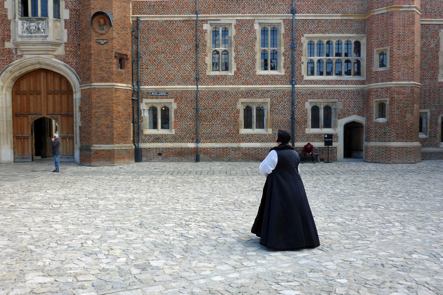 I supect that the courtyard Cardinal Wolsey is strolling across is a lot cleaner now that it might have been (no horses). This is no doubt a route he took often...