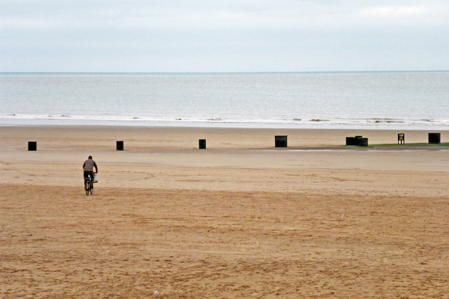 A man driven insane by the isolation, riding his bicycle into the sea.